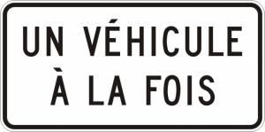 """<a href=""""https://www.signel.ca/product/panonceau-un-vehicule-a-la-fois/"""">Panonceau un véhicule à la fois</a>"""